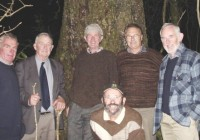 Original Trimble Foundation Members with one of the matai trees in the Trimble forest. From the left are Mike Wyeth, Roddy McKenzie, Jim Weston, Richard Hall, John Kirby and Ian Campbell (kneeling). Dermot Payton is not present.